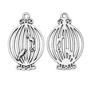 2 st silverfärgade charm, fågelbur